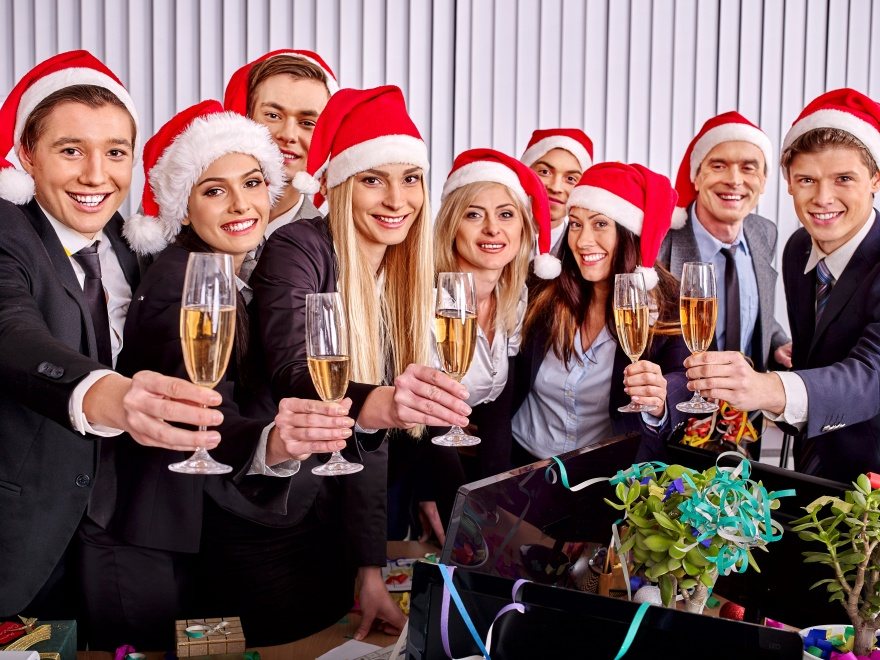 Business group people in santa hat drinking champagne  at Xmas