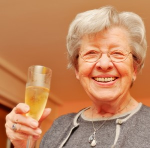 Senior Woman Drinking Champagne 1