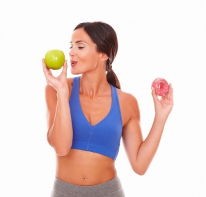 Sporty lady choosing apple over donut