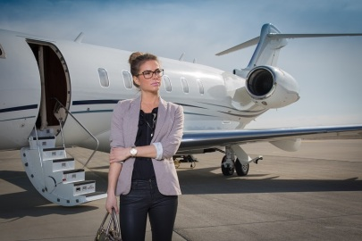 A executive business woman leaving a plane